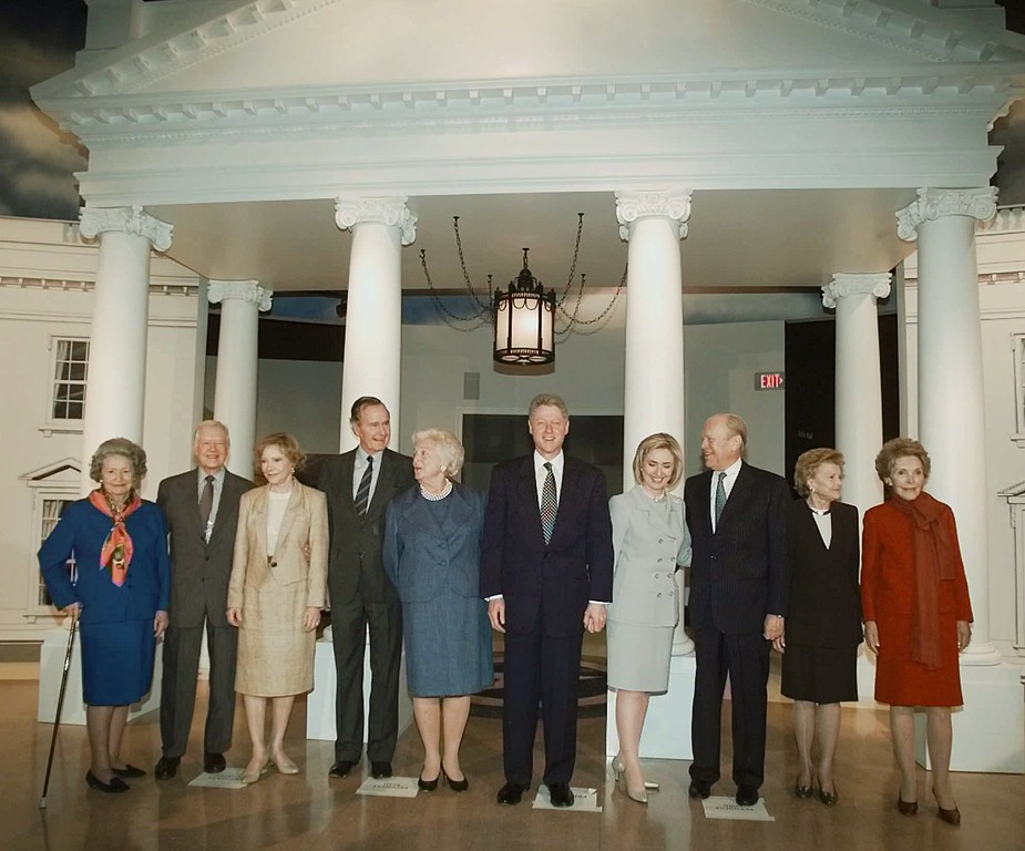 . Current and former occupants of the White House pose for a photo in front of a replica of the presidential residence at the George Bush Presidential Library in College Station, Texas, Thursday, Nov. 6, 1997, prior to the library\'s dedication ceremonies. Shown, left to right, are: Lady Bird Johnson, former President Jimmy Carter, Rosalynn Carter, former President Bush, Barbara Bush, President Clinton, Hillary Rodham Clinton, former President Gerald Ford, Betty Ford and Nancy Reagan. (AP Photo/Susan Walsh)