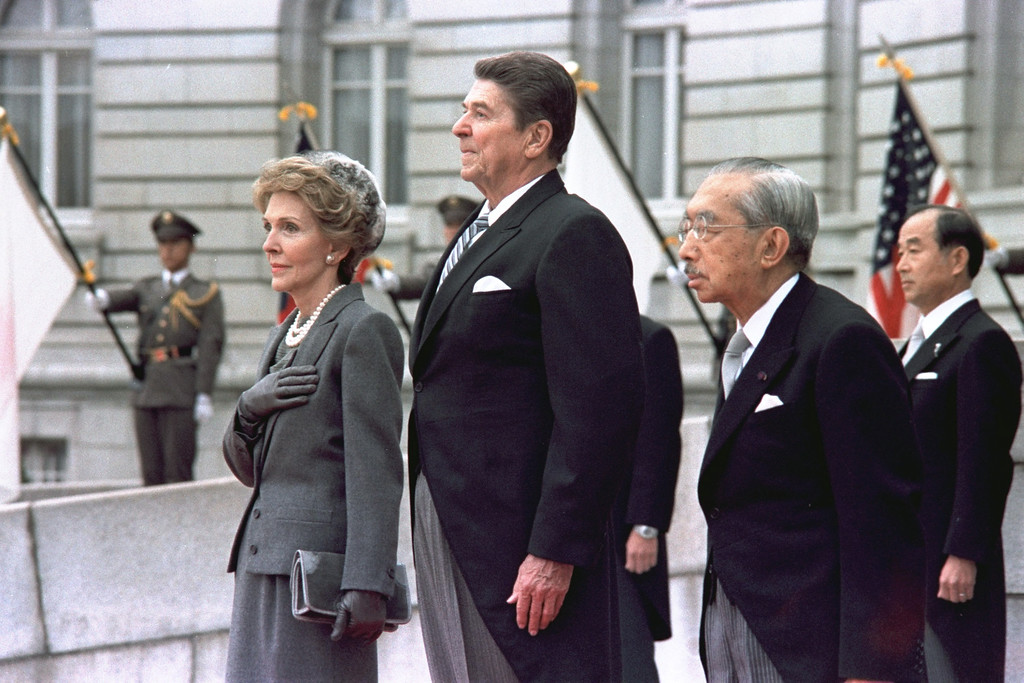 . FILE - In this Nov. 9, 1983 file photo, U.S. President Ronald Reagan and first lady Nancy Reagan stand with Emperor Hirohito at a welcoming ceremony on their arrival in Tokyo. (AP Photo/Sadayuki Mikami, File)