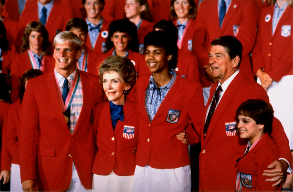 . FILE - In this Aug. 13, 1984, file photo, President Ronald Reagan and Mrs. Nancy Reagan are shown in their Olympic red jackets with USA Olympic medalists at a breakfast meeting at the Los Angeles Century Plaza Hotel. (AP Photo/Red McLenden, File)