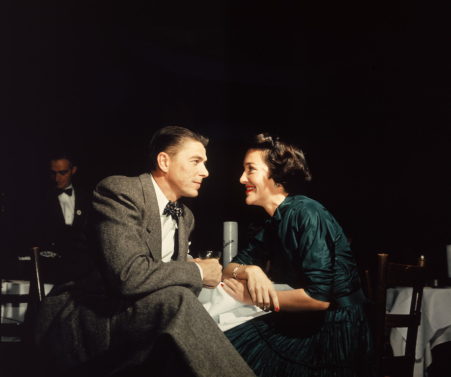 . American actor Ronald Reagan and his wife Nancy Reagan gaze at one another across a table, circa 1952. (Photo by Hulton Archive/Getty Images)