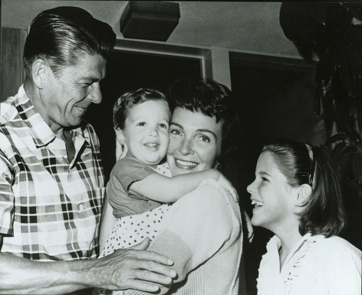 . Ronald and Nancy Reagan with their children, Ron and Patti, outside their Pacific Palisades Home, circa 1960.  Photo Credit: The Ronald Reagan Presidential Foundation