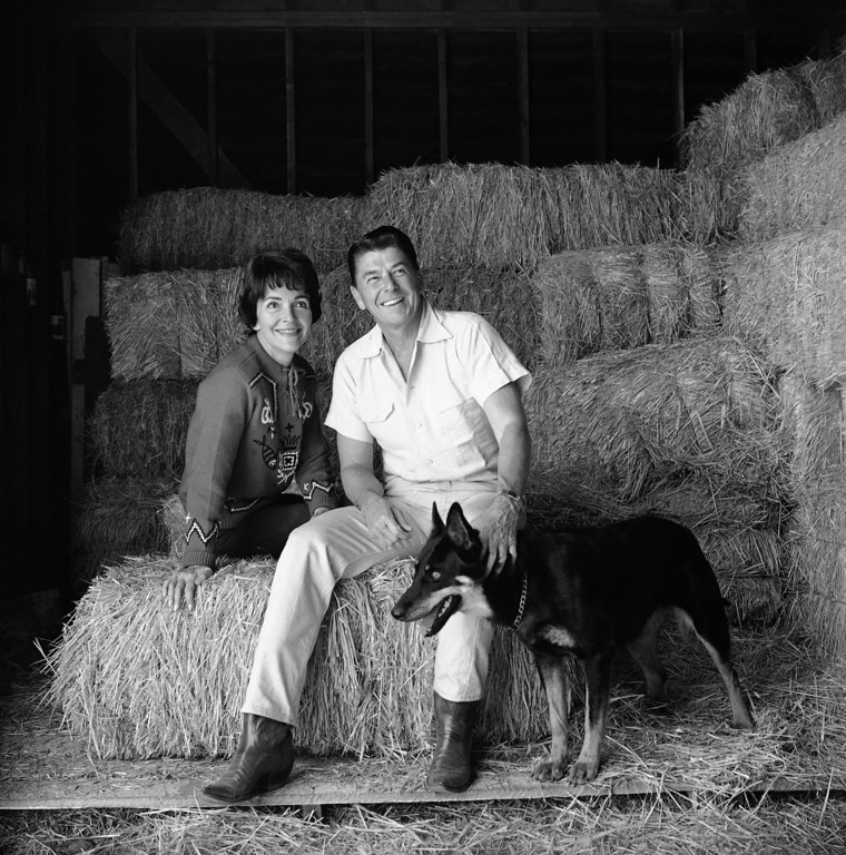 . Actor Ronald Reagan and his wife, actress Nancy Davis, discuss the merits of a tractor on their 305 acre ranch in the Santa Monica, California, mountains on April 8, 1965.  (AP Photo)