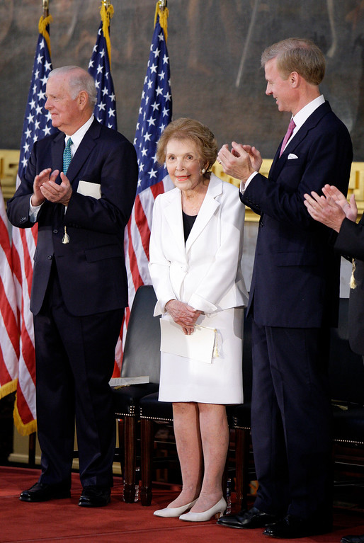 . Former Secretary of State James A. Baker III, left, stands with former first lady Nancy Reagan center, and Frederick J. Ryan Jr., chairman of the Ronald Reagan Presidential Foundation, in the Capitol Rotunda in Washington, Wednesday, June 3, 2009, during a ceremony to unveil a bronze statue of President Ronald Reagan. (AP Photo/Alex Brandon)