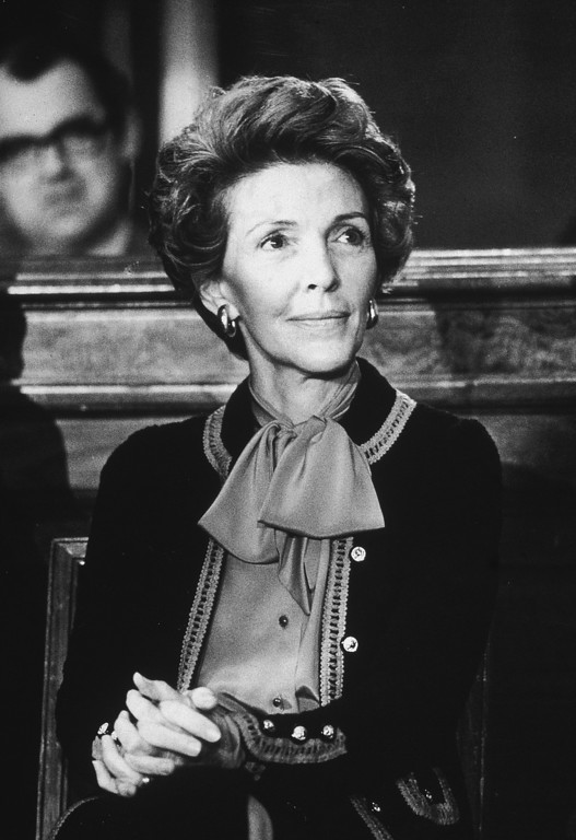 . Nancy Reagan, wife of California governor Ronald Reagan, sits with her hands clasped on her knee at the Governor\'s Press Conference in the Senate Office Building, November 14, 1979. (Photo by Hulton Archive/Getty Images)