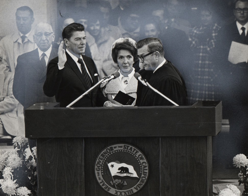 . 1971 - California: Gov. Ronald Reagan being inaugurated while wife Nancy looks on -Chief Justice  Donald Wright Administers the oath.   (File photo)