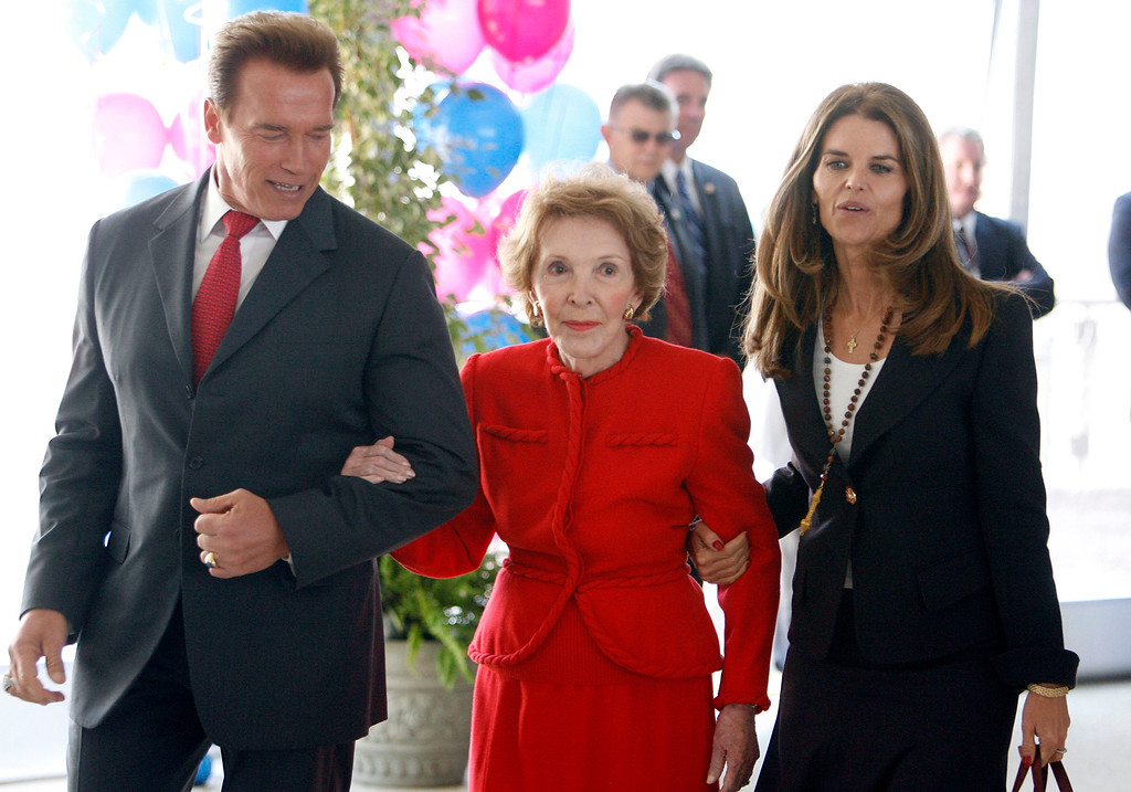 . Former first lady Nancy Reagan, center, walks with California Gov. Arnold Schwarzenegger, left, and California first lady Maria Shriver, before a retrospective honoring the 40th anniversary of former president Ronald Reagan\'s California gubernatorial election, Monday, Oct. 20, 2006, at The Ronald Reagan Presidential Library in Simi Valley, Calif. (AP Photo/Matt Sayles)