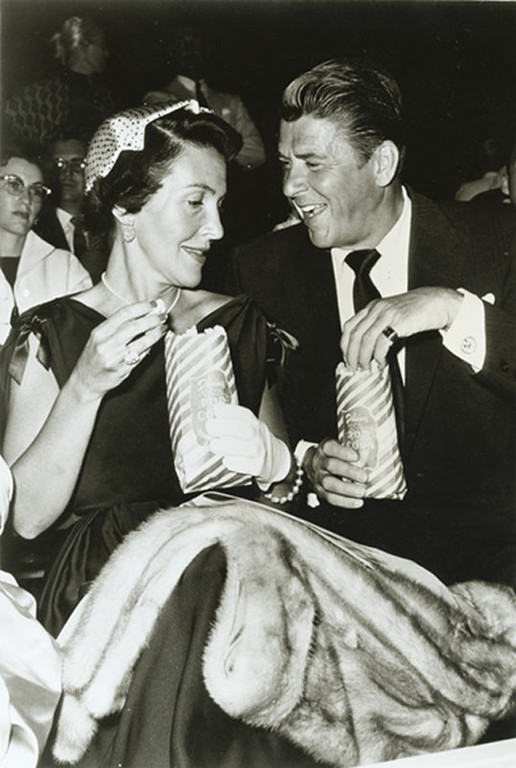 . Ronald and Nancy Reagan eating popcorn at the Ice Capades\' opening, circa 1950s.  Photo Credit: The Ronald Reagan Presidential Foundation