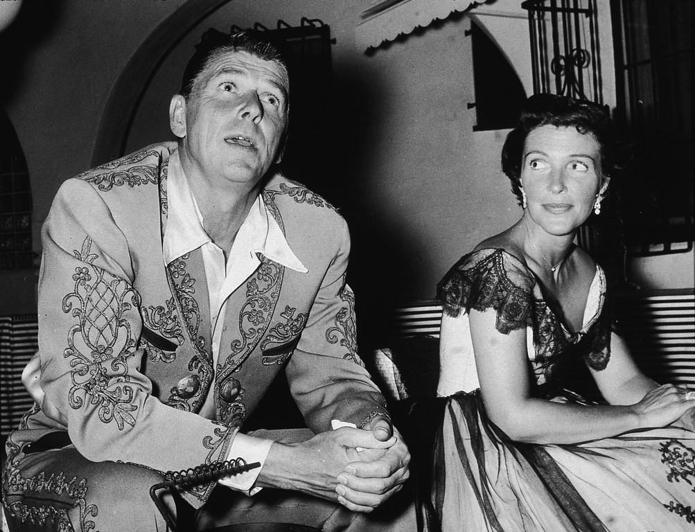 . Future American president Ronald Reagan (1911 - 2004) and his wife Nancy Reagan at a costume party given by Rory Calhoun, 1950s. (Photo by Hulton Archive/Getty Images)
