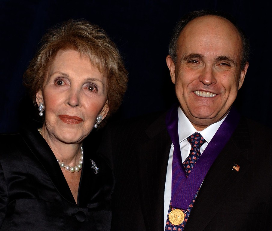 . Former first lady Nancy Reagan poses with former New York Mayor Rudolph Giuliani after presenting him with the Ronald Reagan Freedom Award, Friday, march 8, 2002, in Beverly Hills, Calif. (AP Photo/Lucy Nicholson)