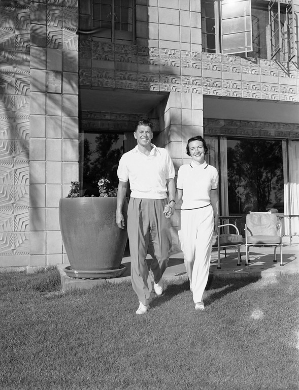 . Actor Ronald Reagan, 40, and his bride starlet Nancy Davis, go for a walk while on their honeymoon at a winter resort in Phoenix on March 6, 1952. (AP Photo/HF)