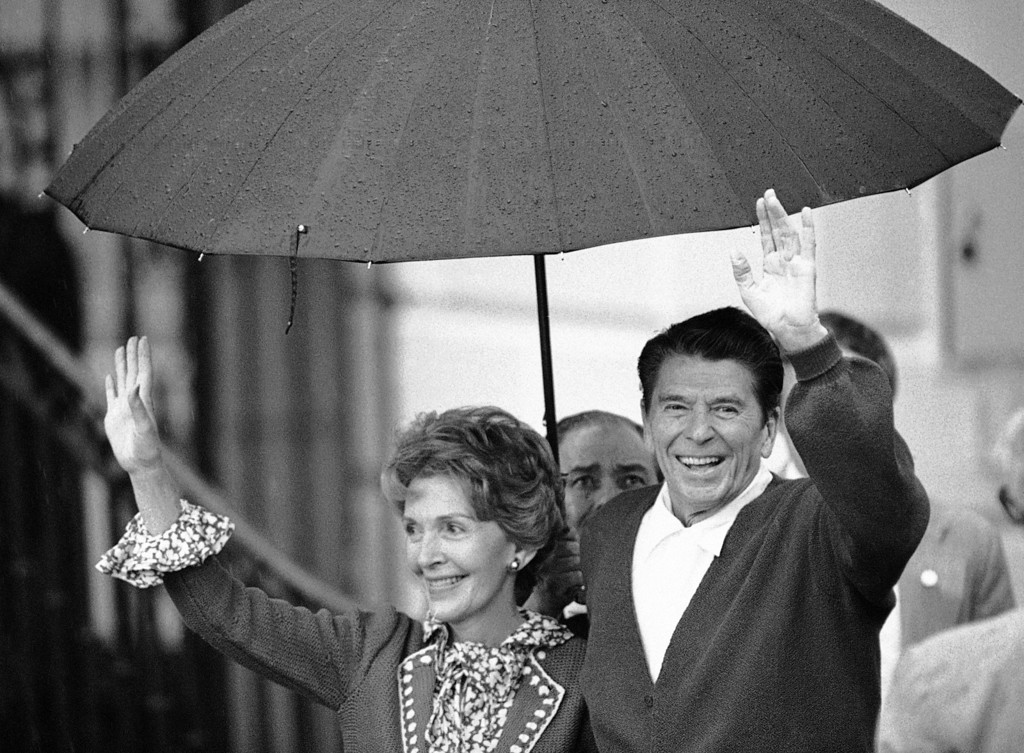 . President Ronald Reagan and Mrs. Nancy Reagan wave to members of the White House staff on the South Lawn in Washington  Saturday, April 11, 1981. Reagan returned to the Executive Mansion after 12 days in the hospital recovering from a shot by a would-be assassin. (AP Photo)