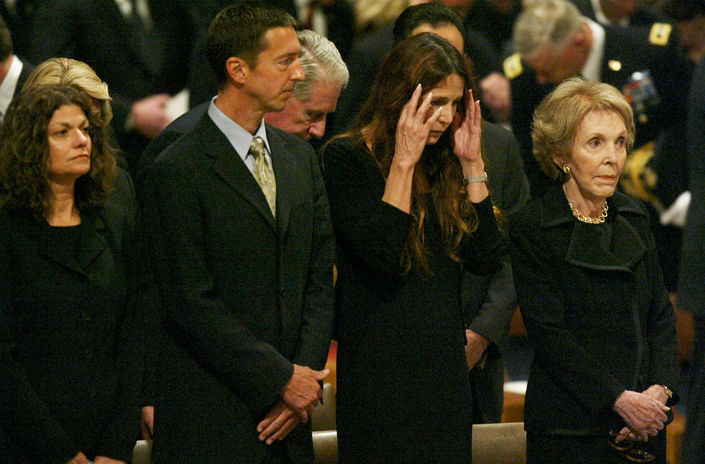 . First lady Nancy Reagan , right, and family, daughter Patti David, second from right, son Ron and Ron\'s wife Doria  take part in funeral services for former President Ronald Reagan at the National Cathedral in Washington Friday, June 10, 2004. (AP Photo/Charles Dharapak)