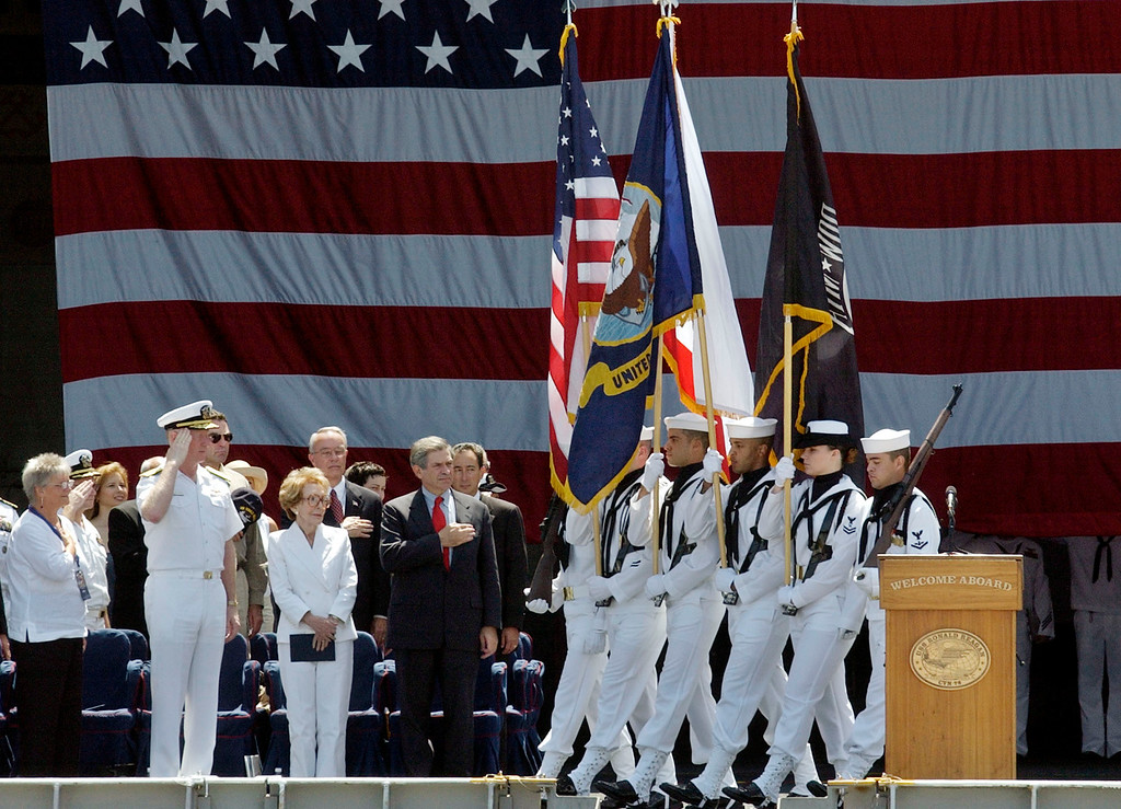 . Nancy Reagan stands with Vice Admiral Michael Malone, left, and Deputy Secretary of Defense Paul Wolfowitz, center, as the color guard passes aboard the aircraft carrier USS Ronald Reagan during its homeporting ceremony at Naval Air station North Island in Coronado, Calif., Friday, July 23, 2004.    (AP Photo/Reed Saxon)