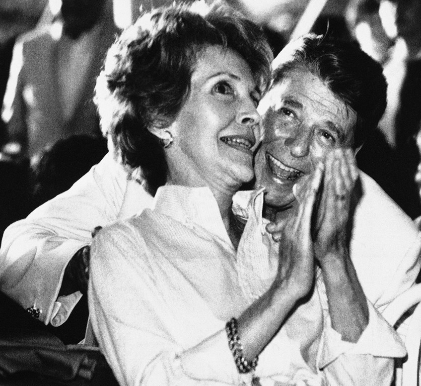 . Pres. Ronald Reagan, right and Nancy Reagan share a laugh during the performance of the Beach Boys at the White House, Sunday, June 12, 1983, Washington, D.C. The rock group provided entertainment for the guests and participants in the Special Olympic festivities. (AP Photo/Scott Stewart)
