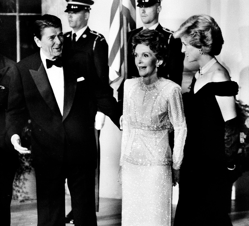 . U.S. President Ronald Reagan and first lady Nancy Reagan welcome Diana, Princess of Wales, right, during a dinner in honor of the Prince and Princess at the White House in Washington, D.C., in this Nov. 9, 1985 file photo.  (AP Photo/Scott Stewart)