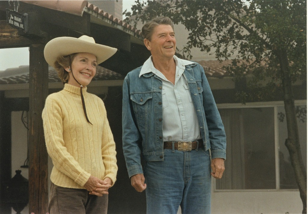 . President and First Lady Nancy Reagan enjoying their time away from Washington, DC, in front of their Ranch house at Rancho del Cielo in Santa Barbara, California, 8/13/81.  Photo Credit: The Ronald Reagan Presidential Library and Museum