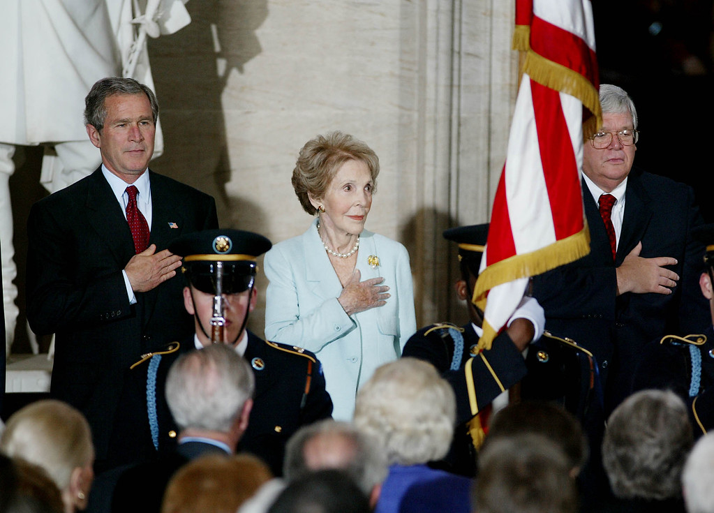 . Former first lady Nancy Reagan, flanked by President Bush and House Speaker Dennis Hastert of Ill. takes part in a ceremony in the Rotunda on Capitol Hill Thursday, May 16, 2002 where she and former President Ronald Reagan were awarded Congressional Gold Medals.  (AP Photo/Ron Edmonds)
