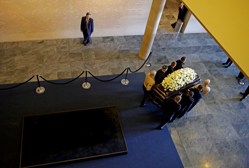 . Pall bearers move the casket of Nancy Reagan out of the public viewing area at the Ronald Reagan Presidential Library, Thursday, March 10, 2016, in Simi Valley, Calif. (AP Photo/Jae C. Hong, Pool)