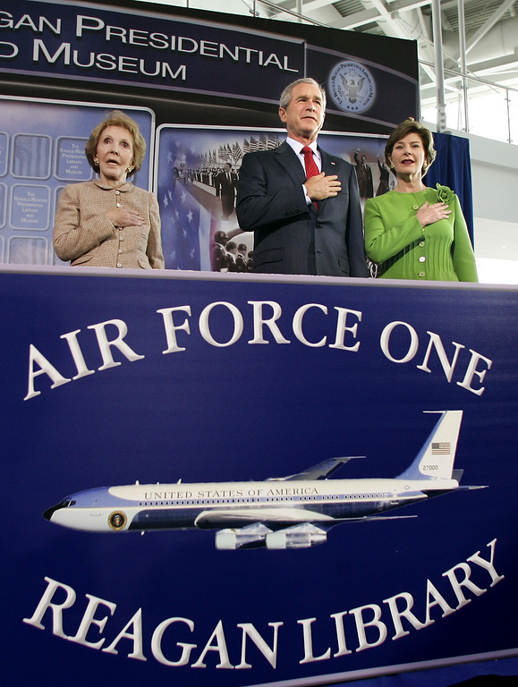 . President  Bush and first lady Laura Bush, join Nancy Reagan, left, the widow of the late President Ronald Reagan, during a prayer at the dedication of the new Air Force One pavilion at the Ronald Reagan Presidential Library in Simi Valley, California, October 21, 2005. The retired Boeing 707 carried President Reagan across America and around the globe during his eight years in office, from 1981 to 1989.  (AP Photo/J. Scott Applewhite)
