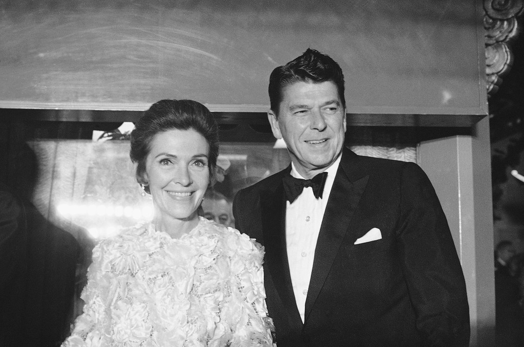 . California Governor Ronald Reagan, and wife Nancy arrive at Grauman\'s Chinese Theatre on December 19, 1969 for the black tie premiere of Hello Dolly.   (AP Photo/David F. Smith)
