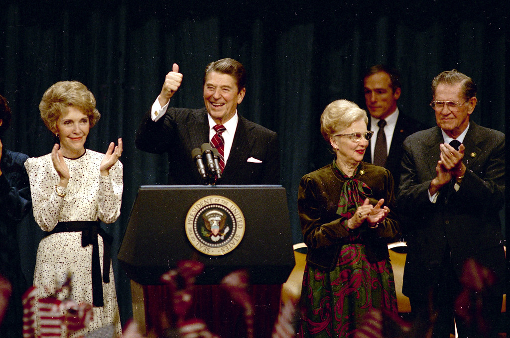 . President Ronald Reagan gives a thumbs-up to supporters at the Century Plaza Hotel in Los Angeles as he celebrates his re-election, Nov. 6, 1984, with first lady Nancy Reagan at his side.  Others are unidentified.  (AP Photo)