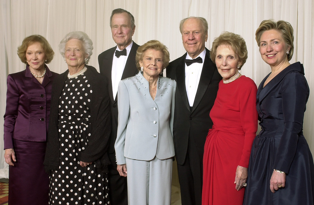 . Former first ladies and presidents get together for a group photo at a gala 20th anniversary fundraising event saluting Betty Ford and the Betty Ford Center Friday, Jan. 17, 2003, in Indian Wells, Calif.  From left are Rosalynn Carter, Barbara and George H.W. Bush, Betty and Gerald Ford, Nancy Reagan and Sen. Hillary Rodham Clinton.    (AP Photo/Reed Saxon)