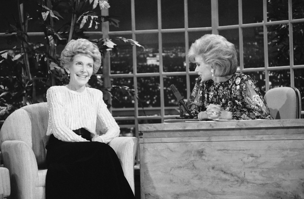 ". FILE - In this Oct. 30, 1986 file photo, talk show host Joan Rivers, right, talks with guest, first lady Nancy Reagan, during her appearance on ""The Late Show Starring Joan Rivers,\"" in Los Angeles.  (AP Photo, Reed Saxon, File)"