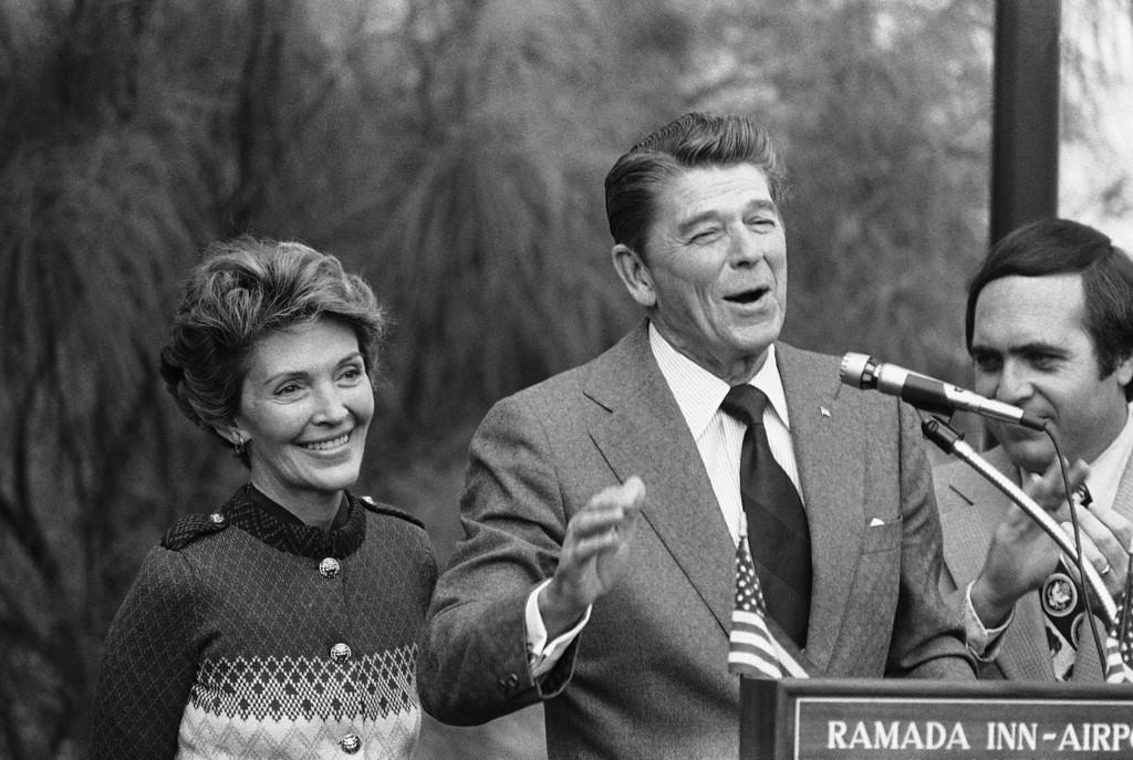 . Ronald Reagan and his wife Nancy were all smiles after arriving on Nov. 20, 1975 in Miami from Washington, D.C. where he announced he would run for the office of the President.   The smiles soon vanished when a man allegedly pulled a toy pistol on Reagan.   Secret Service agents jumped the man and took him away with the Reagan unharmed. (AP Photo/Bill Hudson)