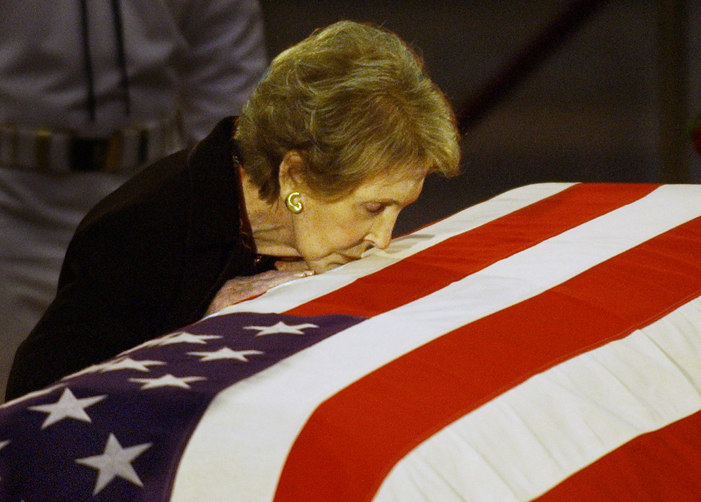 . File - Former first lady Nancy Reagan kisses the casket of her husband former President Ronald Reagan prior to the removal of his remains from the Capitol Rotunda in Washington, Friday, June 11, 2004.  (AP Photo/Elise Amendola)