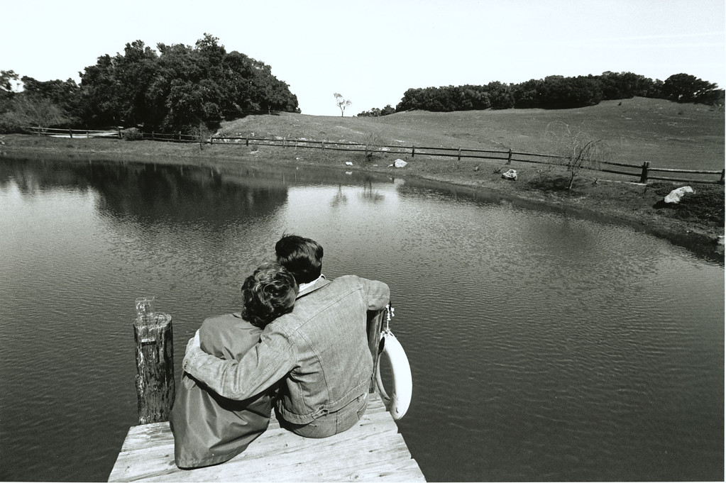 . With the pressures of the White House put aside for a few minutes, President and Mrs. Reagan sit on the dock overlooking Lake Lucky at Rancho del Cielo in Santa Barbara, California, 3/4/82.  Photo Credit: The Ronald Reagan Presidential Library and Museum