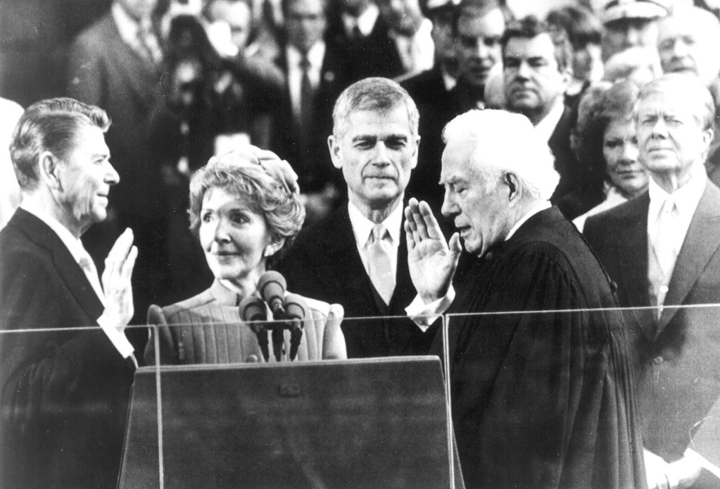 . WASHINGTON, JAN. 20, 1980, REAGAN TAKES OATH  Chief Justice Warren Burger administers the oath of office to Ronald Reagan on Tuesday Jan. 20, 1980 in Washington. Reagan\'s wife Nancy holds the Bible. Outgoing president Jimmy Carter and his wife Rosalynn are at right. Sen. Mark Hatfield, R-Ore., is third from left. (AP-Photo/cam/stf)