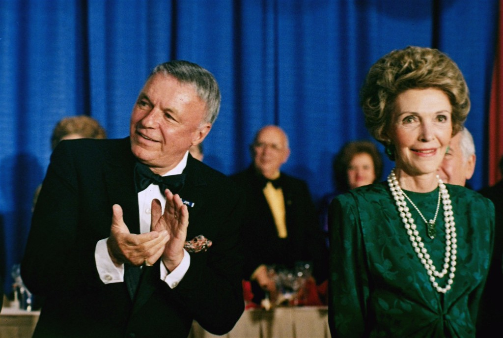 . In this Oct. 19, 1985 file photo, singer Frank Sinatra applauds next to first lady Nancy Reagan at the National Italian-American Foundation\'s 10th Anniversary Gala in Washington.  Sinatra was given a life achievement award by the group. (AP Photo, File)