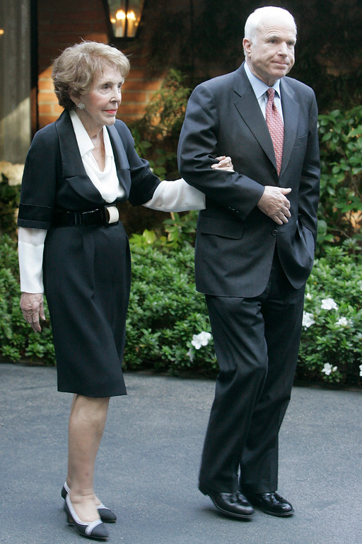. Republican presidential candidate Sen. John McCain, R-Ariz., walks with former first lady Nancy Reagan Tuesday, March 25, 2008 in Bel Air, Calif. Reagan endorsed McCain for president as the Arizona senator continued to collect the backing of leading Republicans who might help him win over critical conservative voters. (AP Photo/Mary Altaffer)