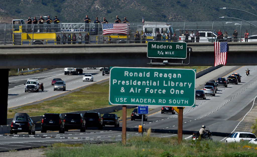 . Firefighters salute as the hearse carrying the body of Nancy Reagan makes its way to the Ronald Reagan Presidential Library, Wednesday, March 9, 2016, in Simi Valley, Calif. (AP Photo/Mark J. Terrill)