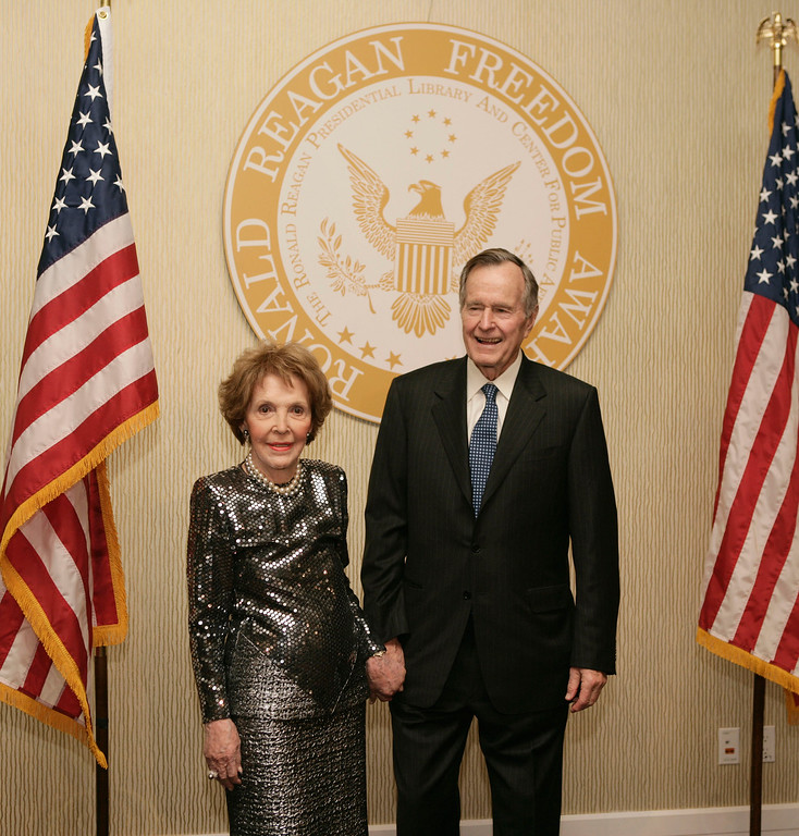 . Former first lady Nancy Reagan and former President George H.W. Bush pose for photographs at the 2007 Ronald Reagan Freedom Award gala dinner honoring Bush, Tuesday, Feb. 6, 2007, in Beverly Hills, Calif. (AP Photo/Matt Sayles)