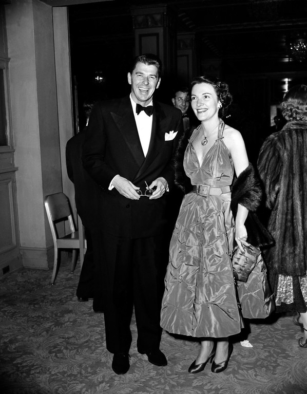 . Actor Ronald Reagan, left, and actress Nancy Davis arrive at the Screen Writers Guild dinner reception at the Ambassador Hotel in Hollywood, Ca., Feb. 20, 1951.  (AP Photo)