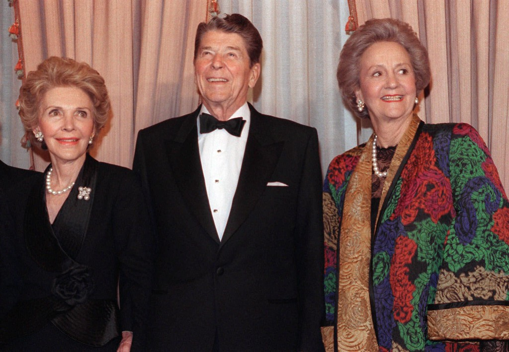. Former President Ronald Reagan, center, poses for photographers with his wife, Nancy Reagan, left, and then-Washington Post Chairperson Katharine Graham in New York, in this March 26, 1991 photo.  (AP Photo/Bebeto Mathews)