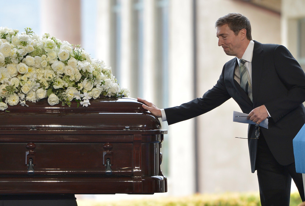 . Ronald Prescott Reagan reaches out to his mothers casket before making his remarks at the funeral service for Nancy Reagan at the Ronald Reagan Presidential Library in Simi Valley, CA March 11, 2016.  (Photo by John McCoy/Los Angeles News Group)