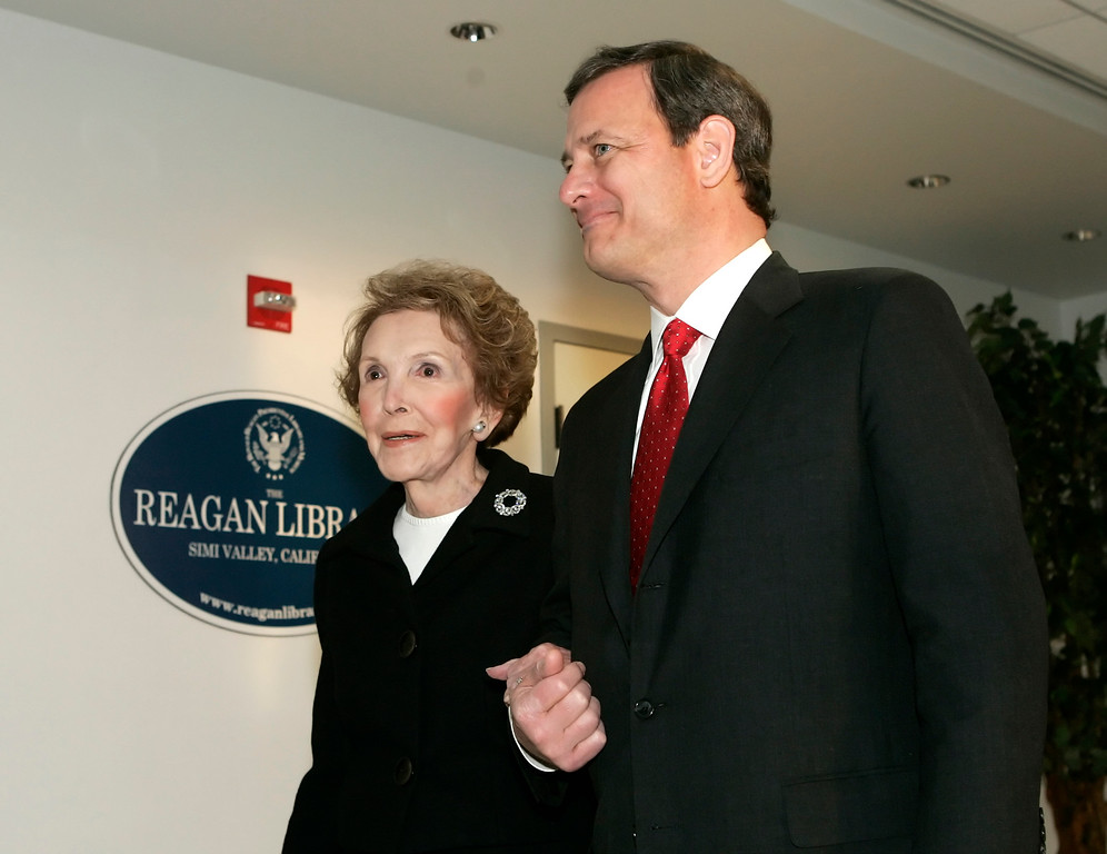 . U.S. Supreme Court Chief Justice John Roberts, right, escorts former first lady Nancy Reagan as they arrive at the Ronald Reagan Presidential Library in Simi Valley, Calif., Wednesday, March 8, 2006. (AP Photo/Kevork Djansezian)