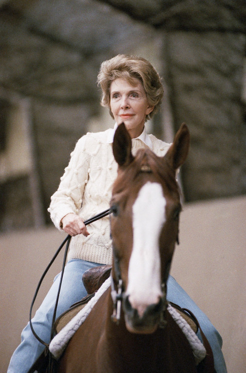 ". First lady Nancy Reagan honorary patron of the National Center for Therapeutic Riding, Inc., rides ""Yankee\"" during a visit to the center on Wednesday, Oct. 19, 1988 in Washington.   NCTR is a non-profit organization which conducts therapeutic horseback riding classes for children and adults with mental and physical disabilities. (AP Photo/Marcy Nighswander)"