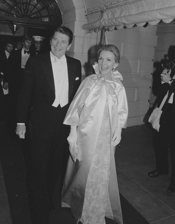 . Pres. Ronald Reagan and first lady Nancy Reagan leave the White House to attend the first of several inaugural balls in Washington, Jan. 20, 1981.  (AP Photo)