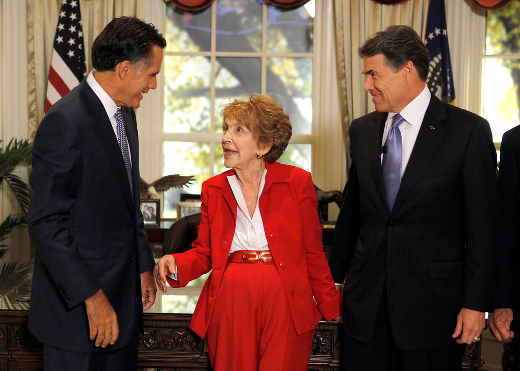 . Republican presidential candidates former Massachusetts Gov. Mitt Romney, left, and Texas Gov. Rick Perry, right, meet with former first lady Nancy Reagan before a Republican presidential candidate debate at the Reagan Library Wednesday, Sept. 7, 2011, in Simi Valley, Calif.  (AP Photo/Chris Carlson, Pool)