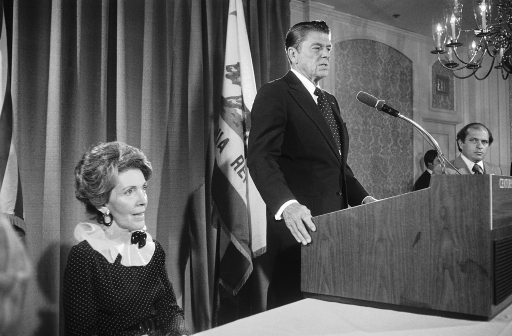 . While his wife Nancy listens, former California Gov. Ronald Reagan addresses newsmen in Los Angeles on Tuesday, May 25, 1976.     Reagan said the California primary will be �very important, in fact, the most important.� (AP Photo/Reed Saxon)