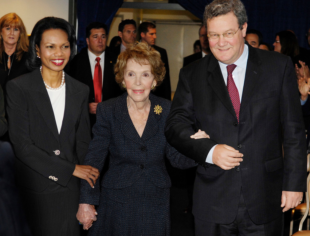 . Former first lady Nancy Reagan, center, is escorted into a news conference by U.S. Secretary of State Condoleezza Rice, left, and Australian Minister for Foreign Affairs Alexander Downer at the Ronald Reagan Presidential Library in Simi Valley, Calif., Wednesday, May 23, 2007. Rice and Downer met for a dialogue on foreign policy issues. (AP Photo/Chris Pizzello)