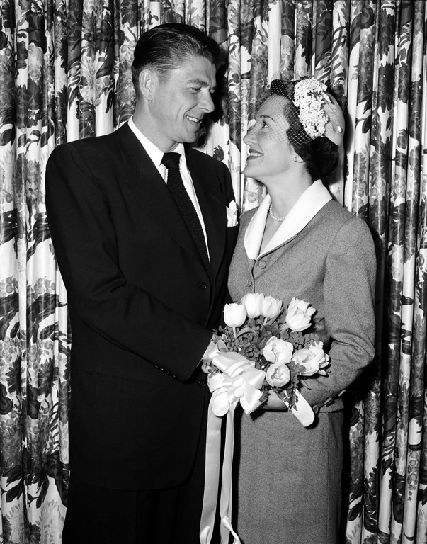 . Actor Ronald Reagan and his bride, actress Nancy Davis, smile at each other as they pose after their marriage in the Little Brown Church of the Valley in North Hollywood, Ca., March 4, 1952.  (AP Photo)