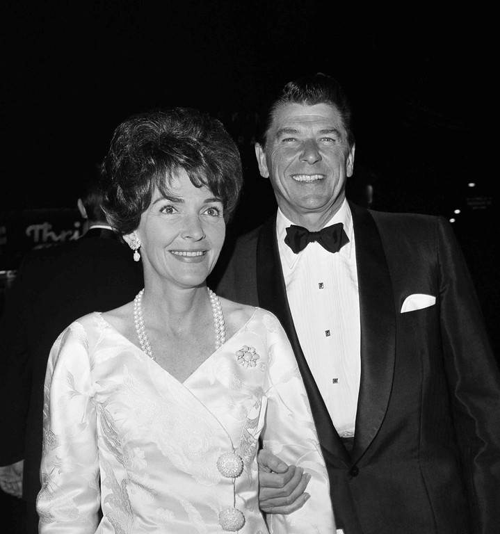 ". Actor Ronald Regan and his wife, Nancy arrive for the premiere of ""Lord Jim\"" on March 4, 1965 in Hollywood, Calif. (AP Photo/ David F. Smith)"