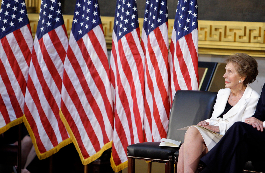 . Former first lady Nancy Reagan sits in the Capitol Rotunda in Washington, Wednesday, June 3, 2009, during a ceremony to unveil a bronze statue of President Ronald Reagan. (AP Photo/Alex Brandon)