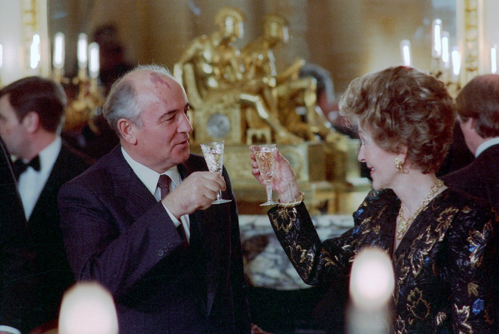 . During the Washington Summit, First Lady Nancy Reagan and General Secretary Mikhail Gorbachev toast at the Soviet Embassy dinner, Washington, DC, 12/9/87. Photo Credit: The Ronald Reagan Presidential Library and Museum