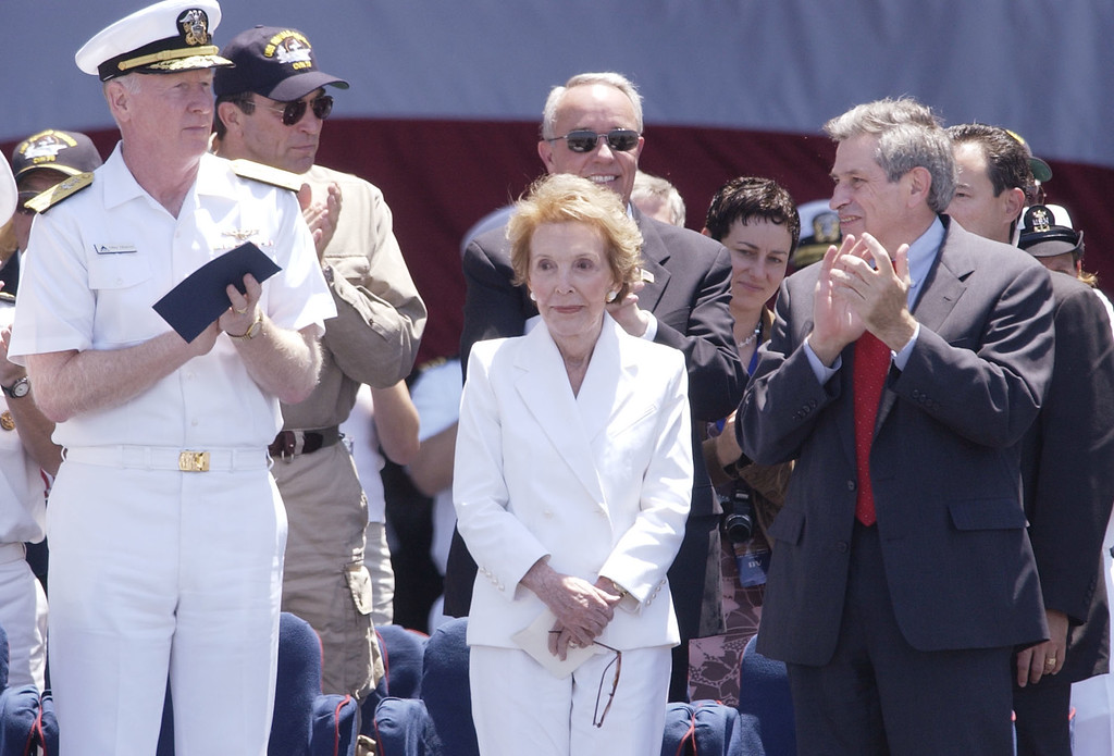 . Nancy Reagan is honored by Vice Adm Michael Malone, L, Paul Wolfowitz, R, and other dignitaries aboard the aircraft carrier USS Ronald Reagan during a homeporting ceremony at Naval Air station North Island in Coronado, Calif., Friday, July 23, 2004.  (AP Photo/Sandy Huffaker)