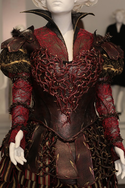. Intricate weaving in an armor-like overlay contrasts with the delicate gown underneath from �Alice Through the Looking Glass.� (Courtesy of ABImages)